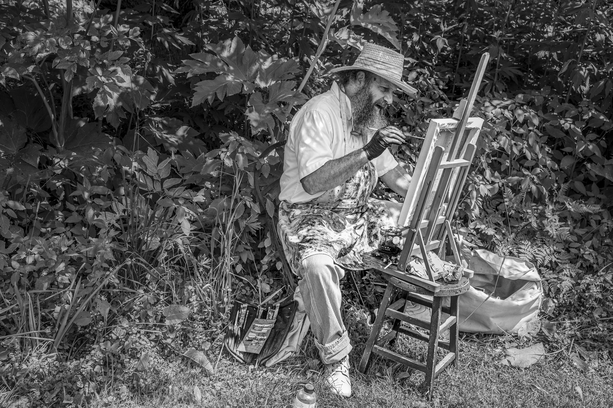 Artist painting in a flower garden